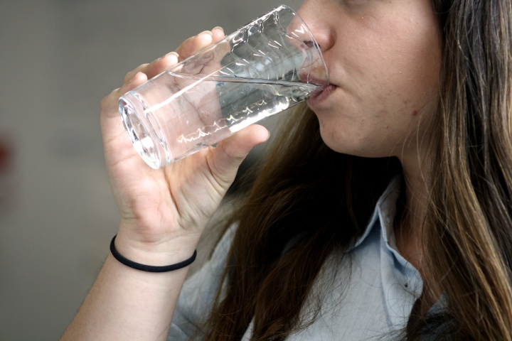 a person drinking a glass of water