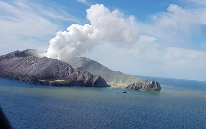 Whakaari/ White Island, with a plume rising from the vent