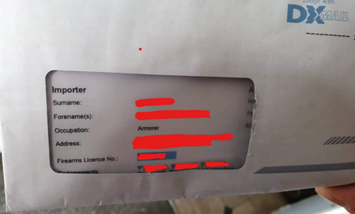 envelope showing a firearms liscence number and the words 'importer' through the window, along with name, occupation, and address (details blanked out)